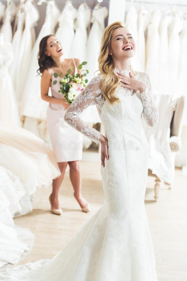 Laughing bride and bridesmaid in wedding royalty free stock photo