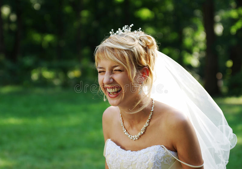 Laughing bride outdoors in summer stock images