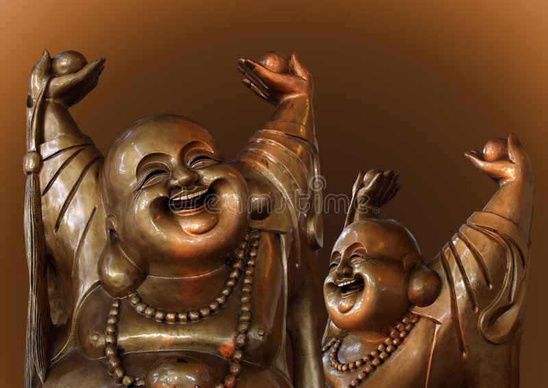 Laughing Buddha figures stock image