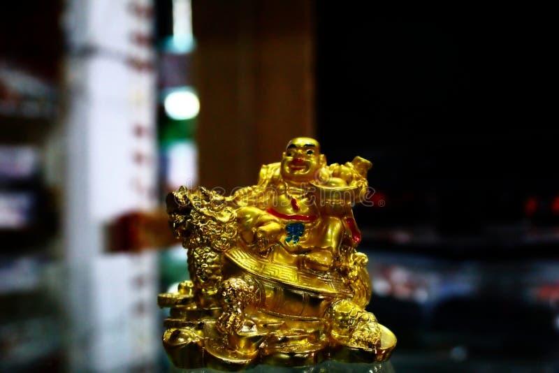 A Laughing Buddha se le conoce popularmente como un Buda feliz fotos de archivo libres de regalías
