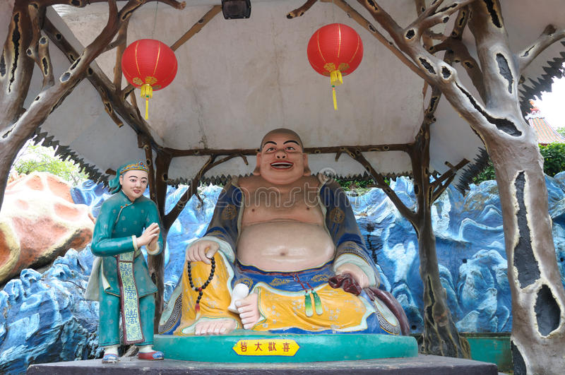 The Laughing Buddha statue at Haw Par Villa in Singapore. A photo taken on the Laughing Buddha staue at Haw Par Villa in Singapore stock image