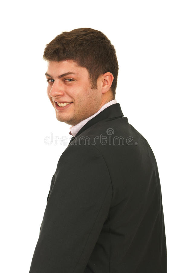 Laughing business man looking back. Over his shoulder isolated on white background royalty free stock images