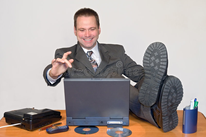 Laughing businessman. Works in office royalty free stock image