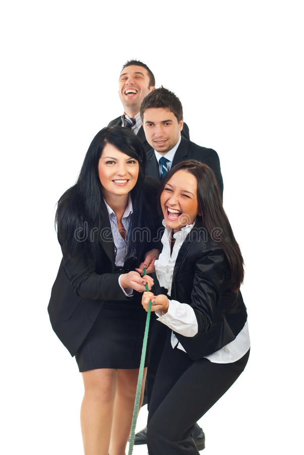 Laughing businesspeople playing tug of war. Laughing four team of business people playing tug of war isolated on white background stock images