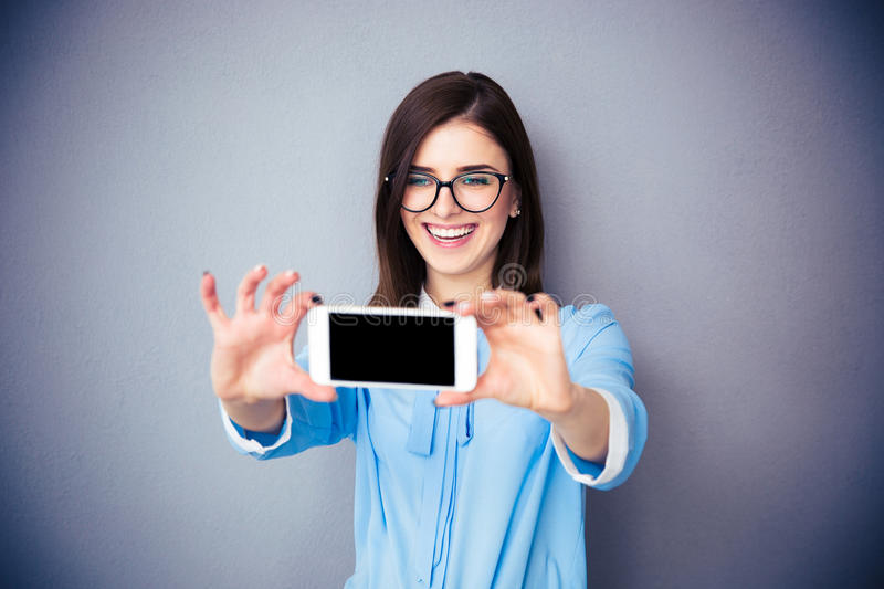 Laughing businesswoman making selfie photo royalty free stock photo