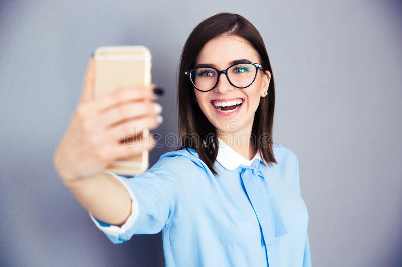Laughing businesswoman making selfie photo stock photo