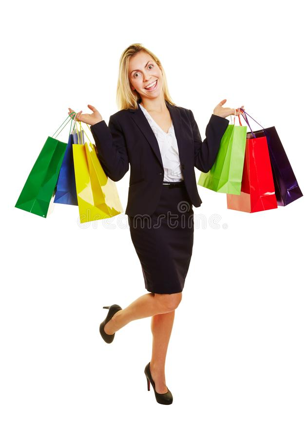Laughing businesswoman with shopping bags royalty free stock photography