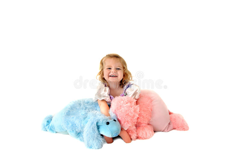 Download Laughing Child Holding Toy Poodles Stock Photo - Image: 13531724