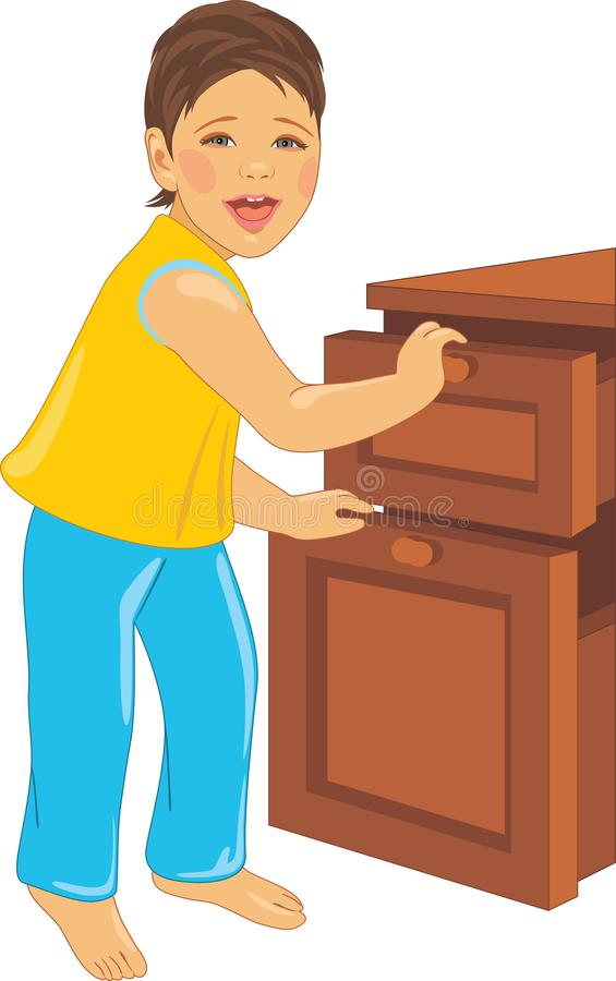 Laughing child opens the dresser stock image