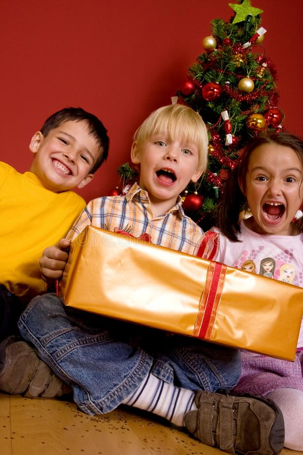 Download Laughing Children With Christmas Gift Stock Photo - Image: 7064992