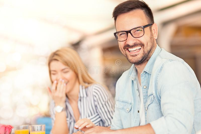 Laughing couple during breakfast royalty free stock photo