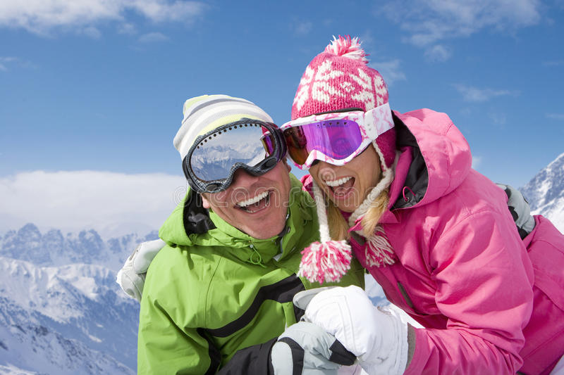 Laughing couple on mountain top royalty free stock photography