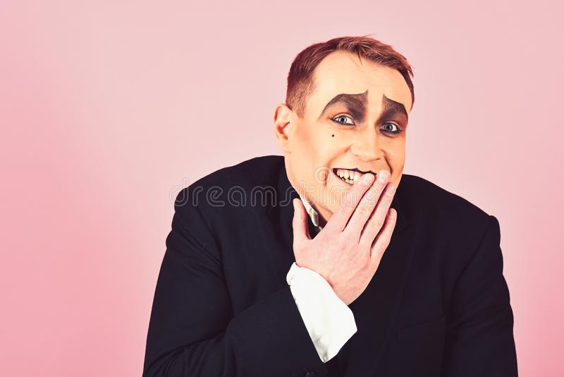 Laughing face. Comedian performer giggling. Mime artist. Mime with face paint. Man with mime makeup. Theatre actor royalty free stock images