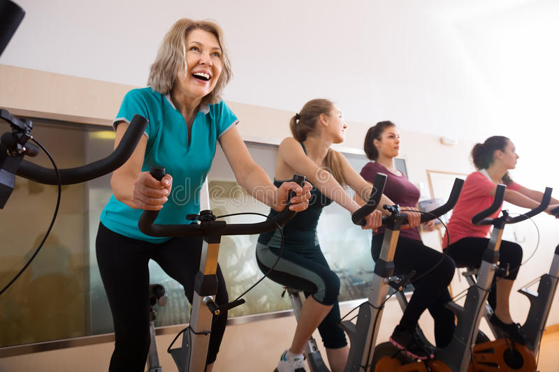 Laughing Females Of Different Age Training On Exercise Bikes Stock