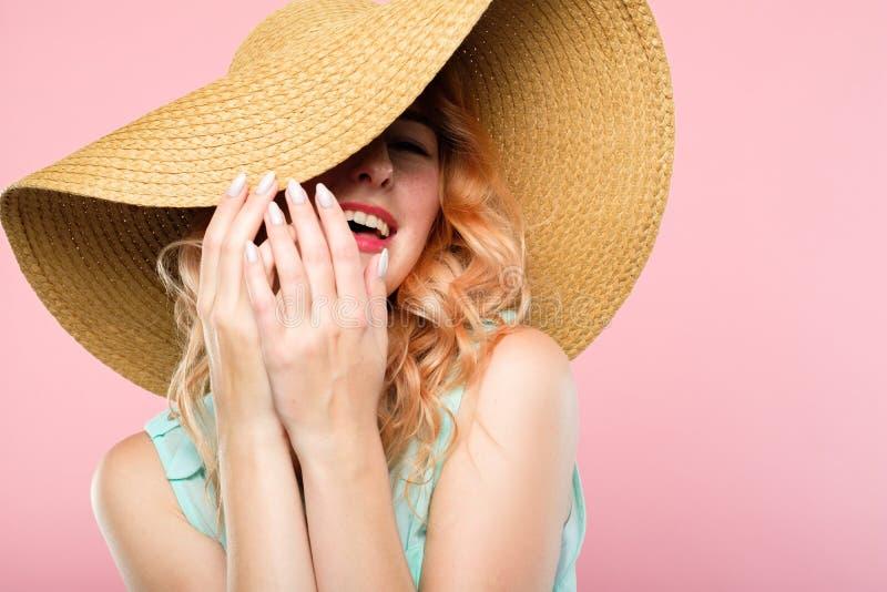 Laughing frolic woman sunhat summer fashion beauty royalty free stock photos