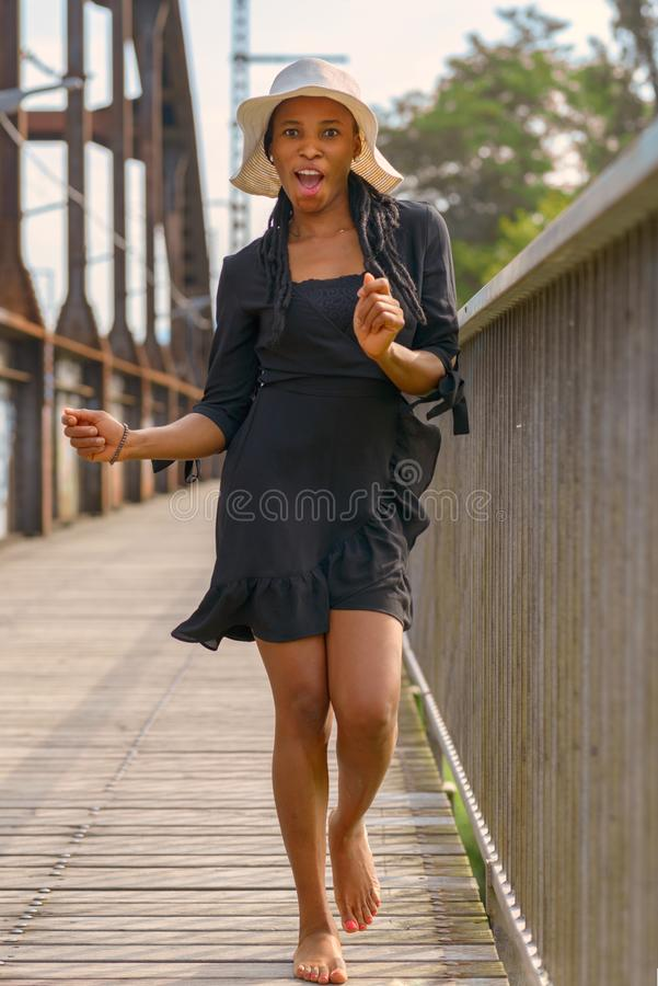 Laughing fun loving young African woman stock photo