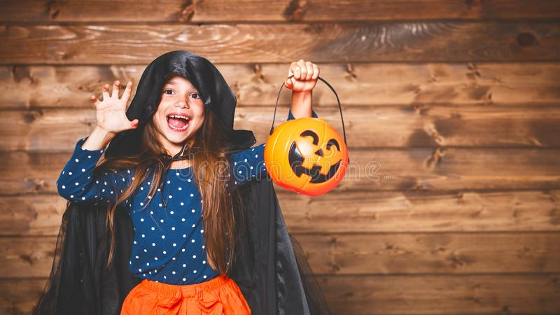 Funny child girl in witch costume in halloween royalty free stock image