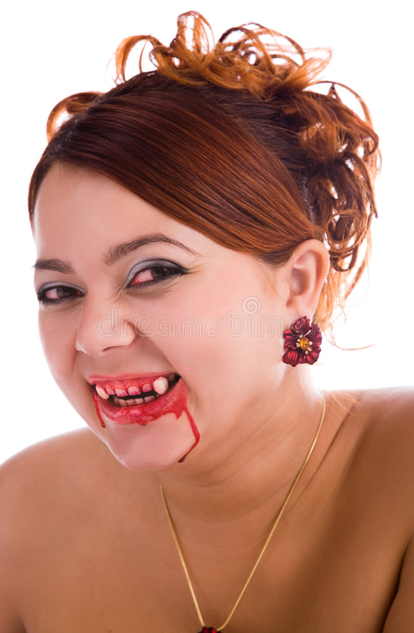 Laughing funny vampire woman. With fresh blood on the lips royalty free stock photography