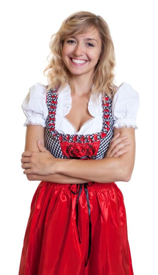 Laughing german woman with crossed arms in a traditional bavarian dirndl. On an isolated white background for cut out stock photography