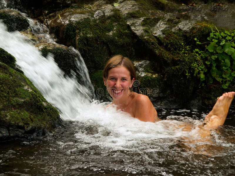 Laughing girl bathing royalty free stock photography
