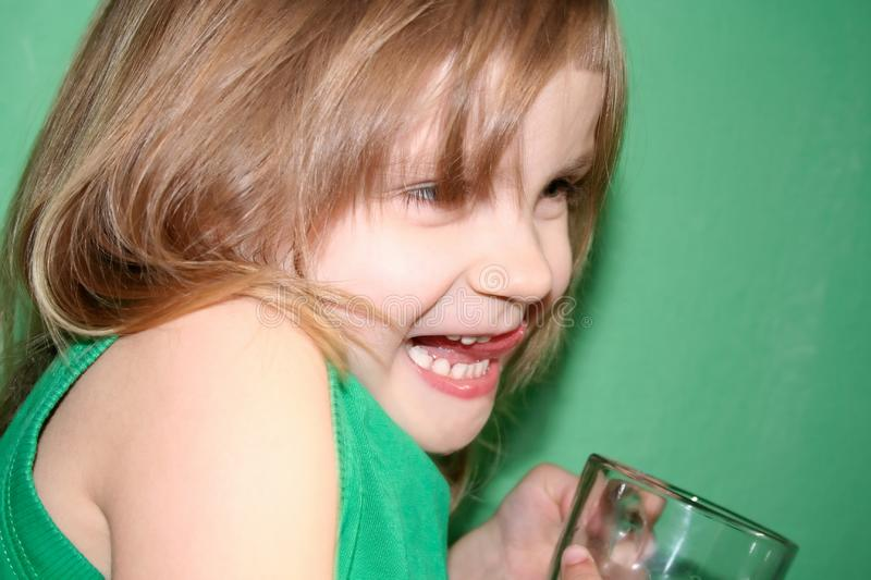 Laughing girl with a cup royalty free stock photo