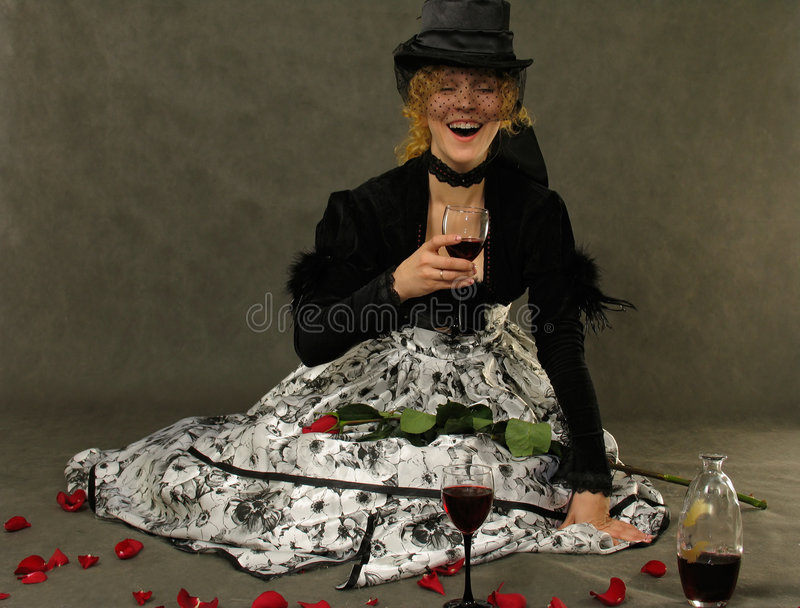 Laughing Girl with glass of wine stock photography