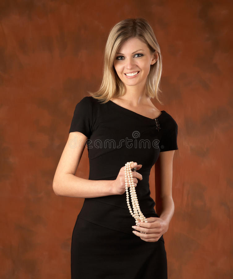 The laughing girl with pearls royalty free stock photos