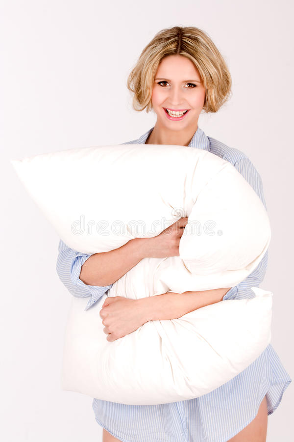Download Laughing girl with pillows stock image. Image of european - 19138391
