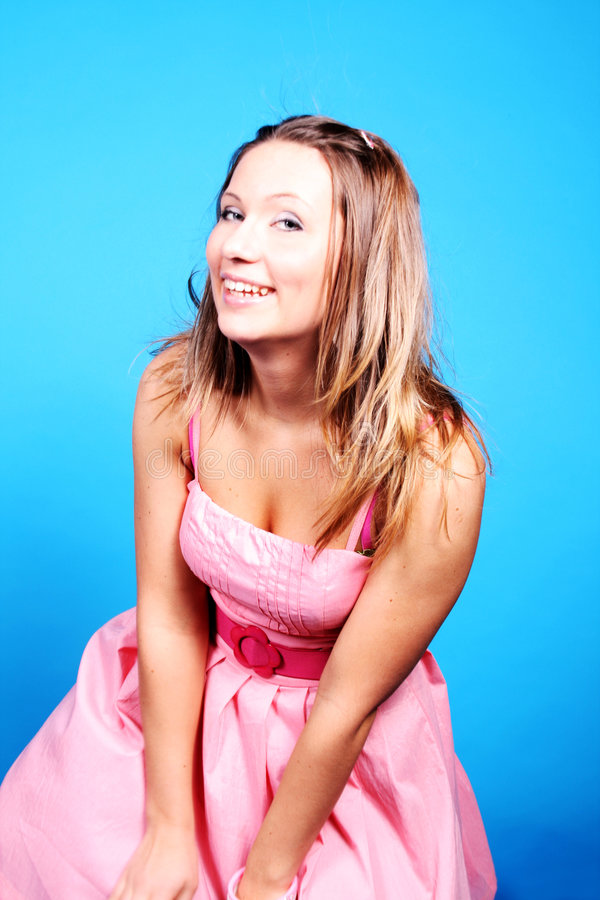 A laughing girl in pink dress
