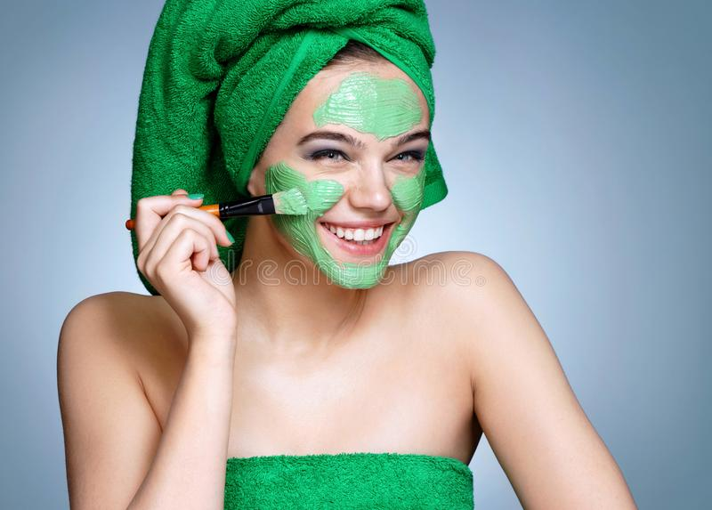 Download Laughing Girl Receiving Cosmetic Facial Mask. Stock Image - Image of concept, cream: 117718913