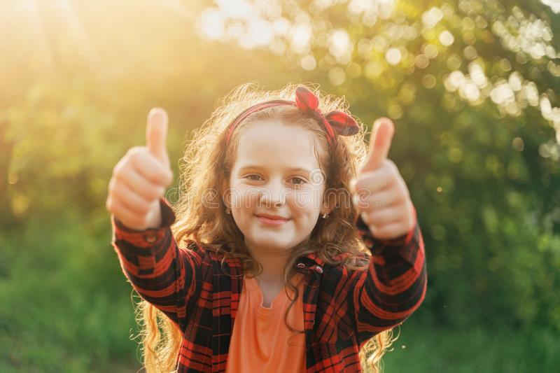 Laughing girl  showing thumbs up stock images