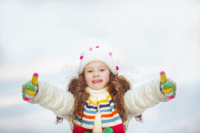Laughing girl showing thumbs up. stock photos