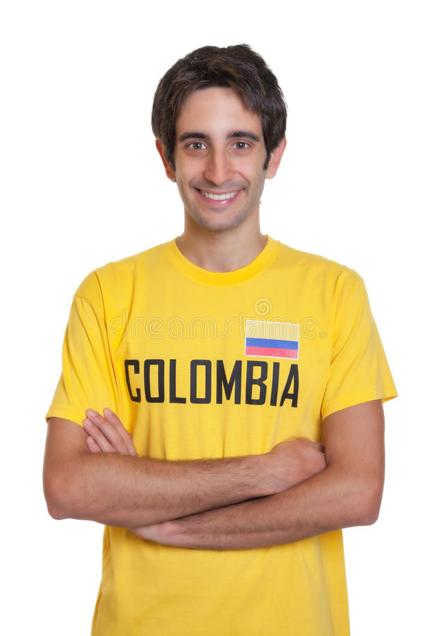 Laughing guy from Colombia with crossed arms looking at camera. On an isolated white background for cut out royalty free stock photo