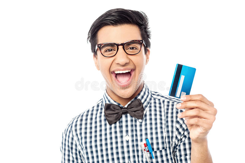 Laughing guy holding credit card royalty free stock images