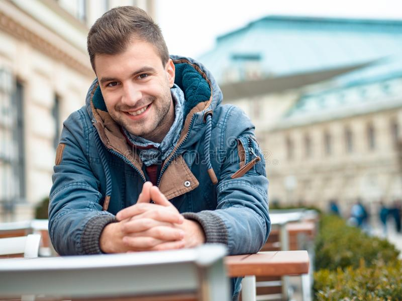 Laughing handsome man looking at camera with smile. Outdoor, outside stock photography