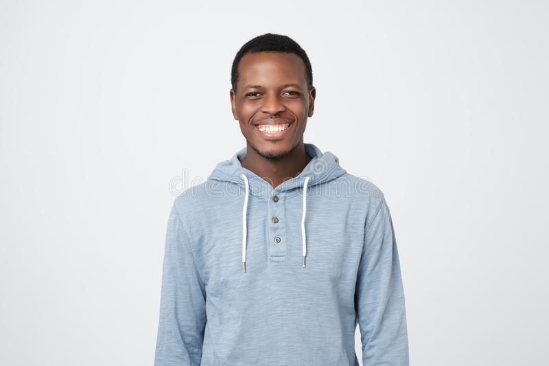 Laughing handsome young african man smiling confident stock photo