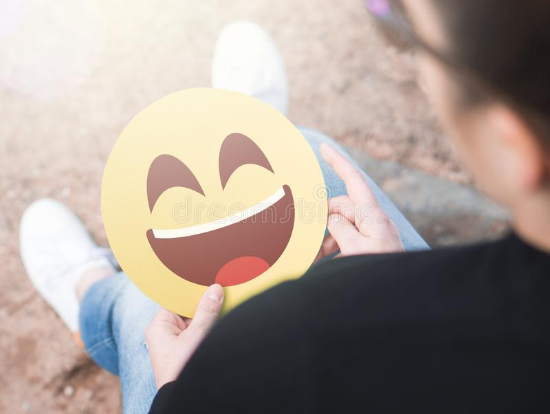 Laughing happy emoticon in hand. stock photos