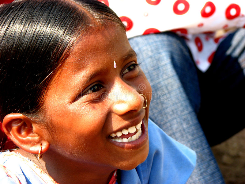 Laughing Heartily. A Indian girl laughing heartily royalty free stock images