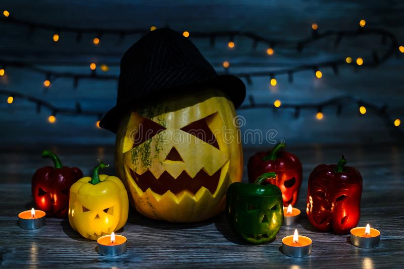 Laughing jack-o-lantern in hat with scary scar on the face and h stock photos