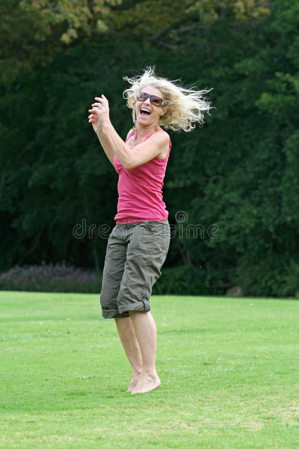 Download Laughing And Jumping, Healthy Woman Enjoying Herself! Stock Photo - Image: 2029660