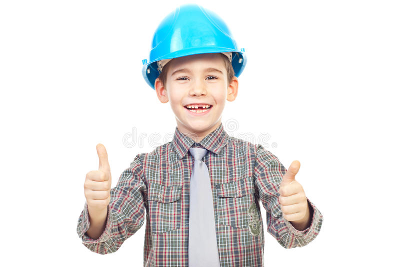 Laughing kid with helmet give thumbs royalty free stock photos