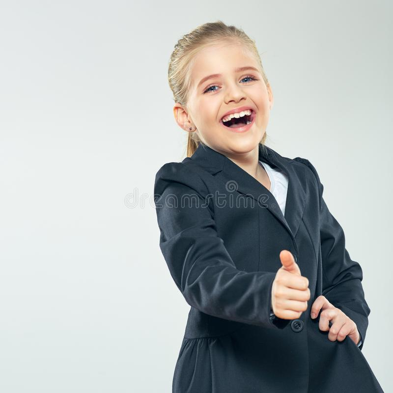 Laughing little business woman show thumb up. Child girl in bus royalty free stock image