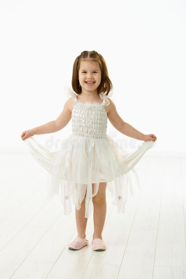 Laughing little girl in ballet costume