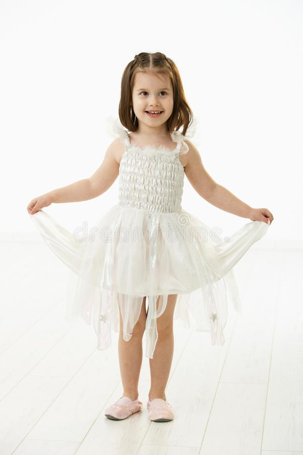 Laughing little girl in ballet costume royalty free stock images