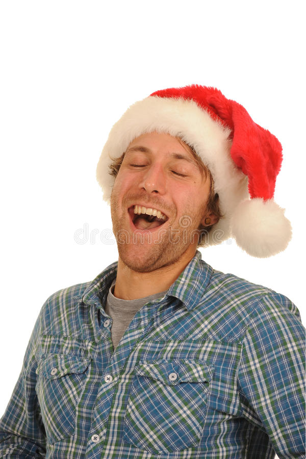 Laughing man in santa hat. Laughing young man wearing a Santa hat royalty free stock photography