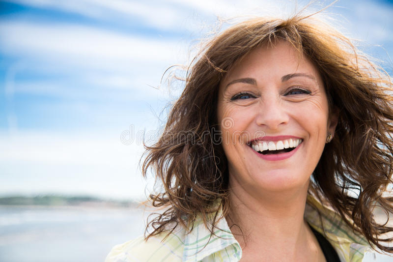 Laughing middle aged woman royalty free stock photo