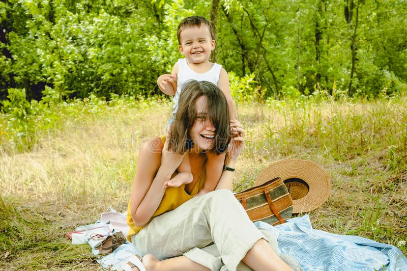 laughing mother holding son on shoulders stock image