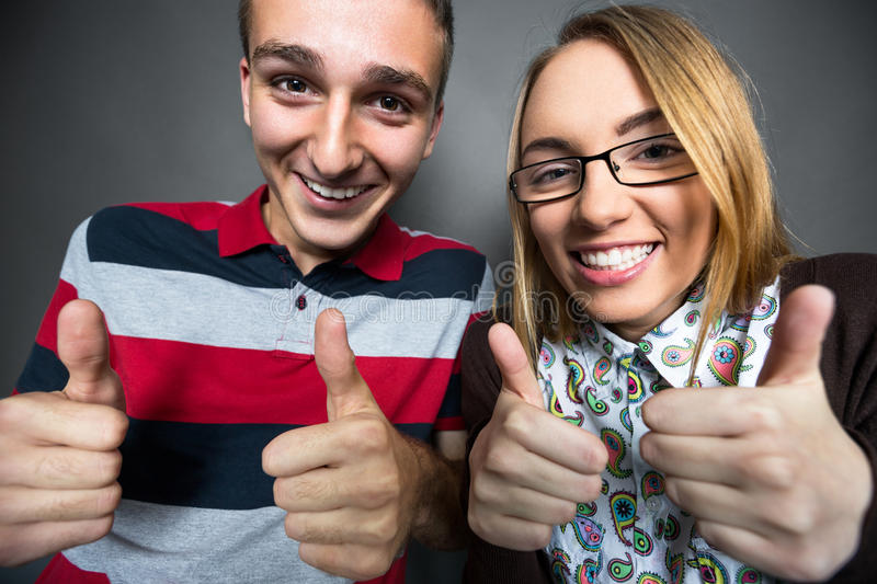 Laughing nerdy couple royalty free stock photos