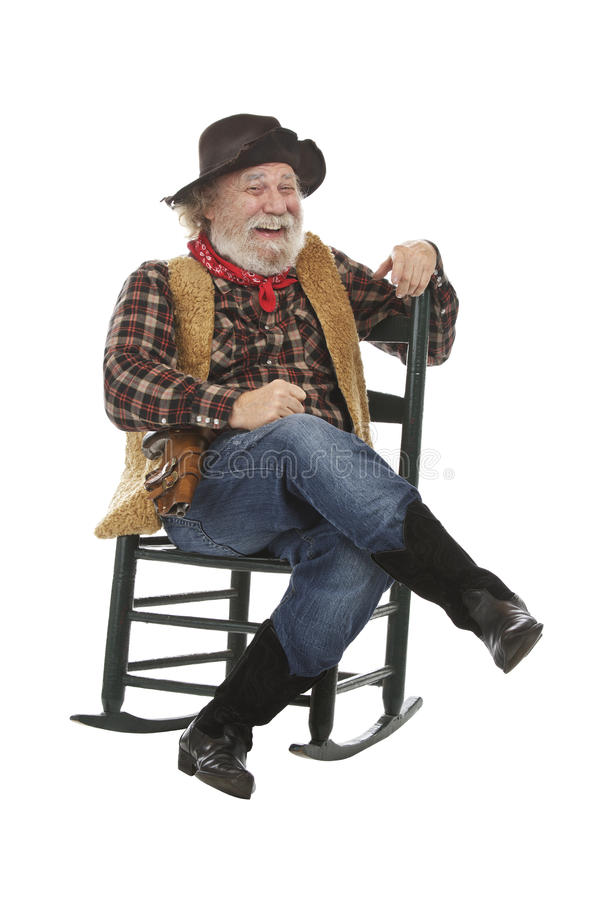Laughing Old Cowboy Sits In Rocking Chair Royalty Free Stock Images