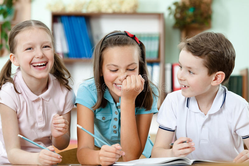 Download Laughing Pupils Help To Each Other Stock Image - Image: 26323169